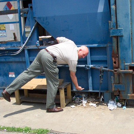 Jim found Destin under this garbage dumpster near his work.
