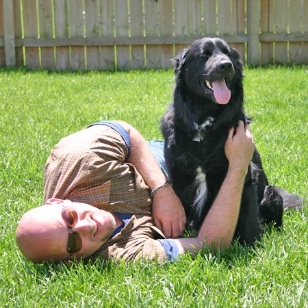Destin and Jim playing in the backyard.