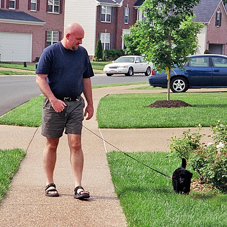 Jim walking Destin on a leash for the first time.