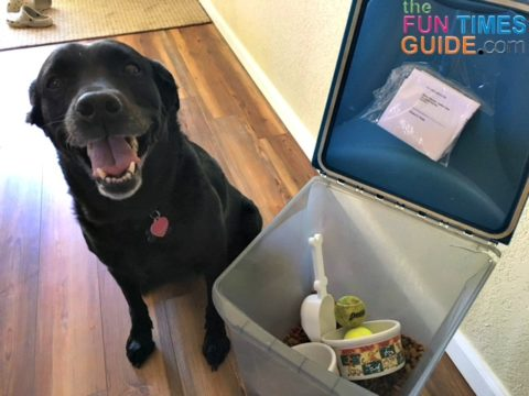 Our dog food container serves many purposes -- it holds the dog food, food & water dishes, balls, vet records and our veterinarian's contact number.