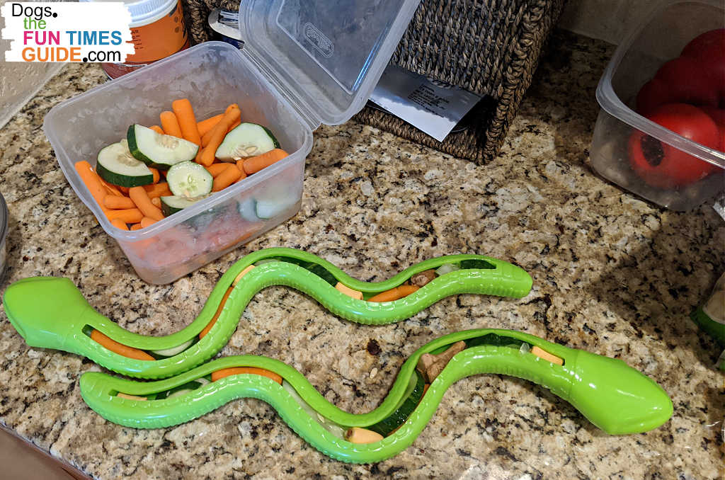 Two snake dog treat toys stuffed with crunchy vegetables.