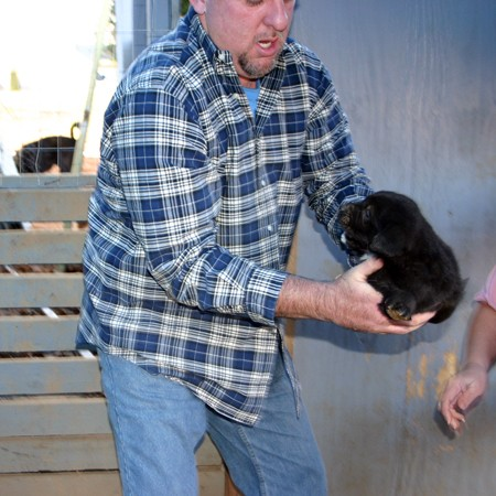 jim-picking-up-tenor-puppy.jpg