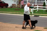 Jim walking Destin on a loose leash while focusing on eye contact.
