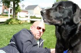 jim-with-tenor-dog-in-front-yard.jpg