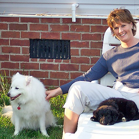 Lynnette with Jersey and Destin in the backyard.