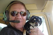 pilot-with-dog-wearing-mutt-muffs.jpg