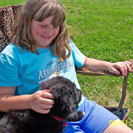 Destin loves playing with Sean's daugher, Shelby at the softball games.